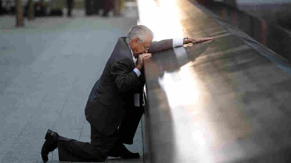 Robert Peraza, who lost his son Robert David Peraza, pauses at his son's name at the North Pool of the 9/11 Memorial at the site of the World Trade Center.