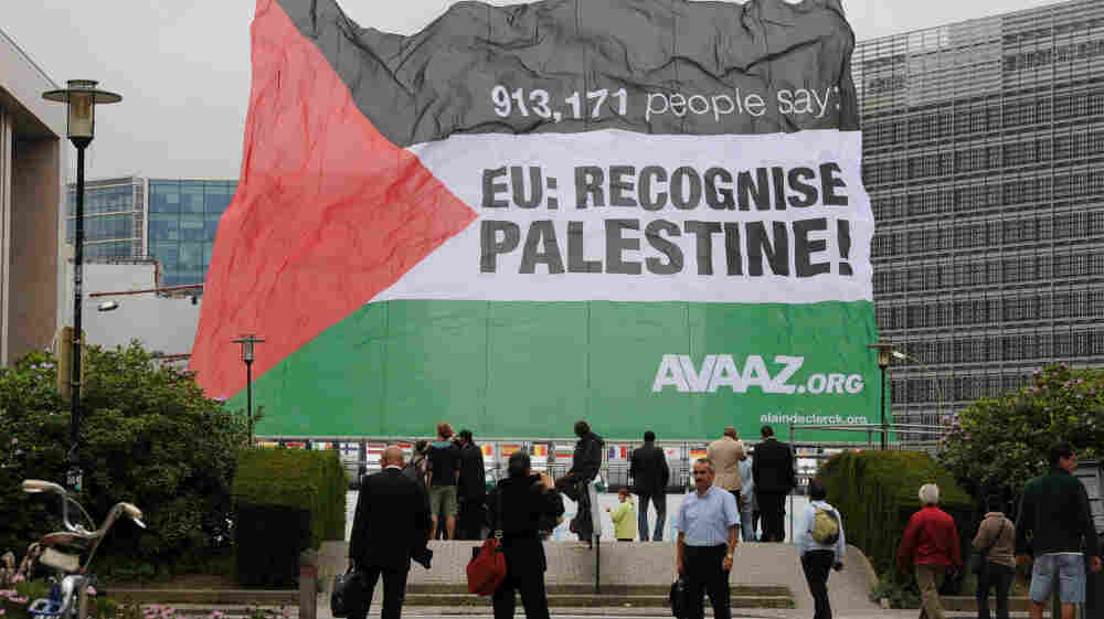 A Palestinian flag is raised in front of European Union headquarters in Brussels on Monday. The Palestinians are expected to seek statehood at the United Nations next week.