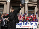Texas Gov. Rick Perry waves to the crowd after speaking at an anti-abortion rally on the Capitol steps in Austin on Jan. 23, 2010.