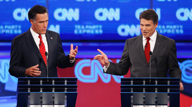 Former Massachusetts Gov Mitt Romney (left) and Texas Gov. Rick Perry during Monday's debate in Tampa.