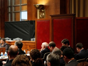 Ali Soufan testifies from behind a black curtain and a room divider to protect his identity in 2009, during a Senate hearing to examine the Bush administration's detention and interrogation program.