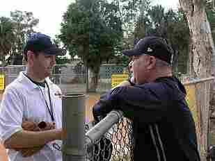 "Brad Meltzer, who coaches Little League Baseball, talks with his father, Stewart ""Stewie"" Meltzer. Brad's father and his grandfather were both hit by lightning."
