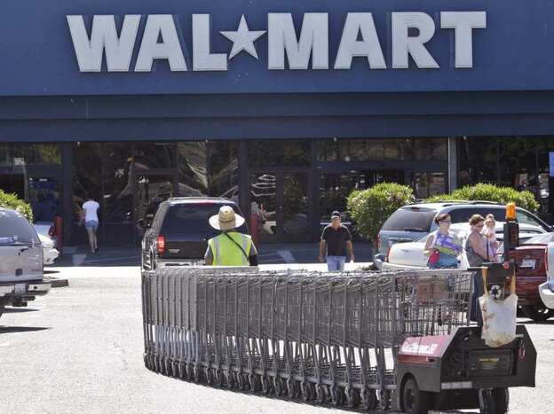 In virtually every county, there is a  Walmart open every hour of every day, and  every one of those Walmarts  is being visited by 37,000 people a week —  that's 220 people an hour,  in every Walmart, every hour of  the day. Here, a Walmart worker pulls carts at a store in Pittsburg, Calif.