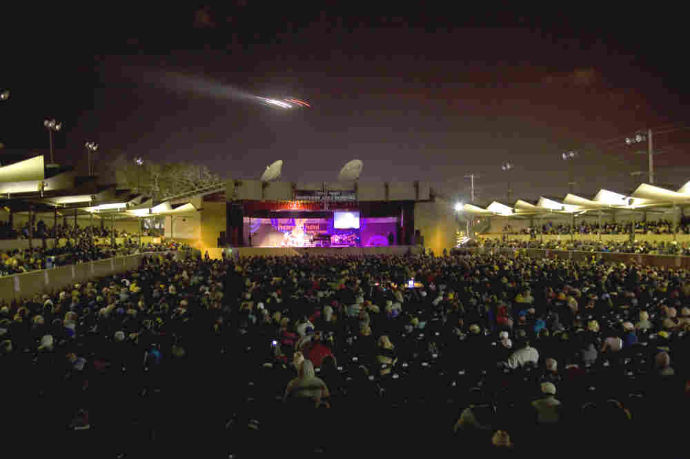An airplane flies over the Arena Stage of the Monterey Jazz Festival.