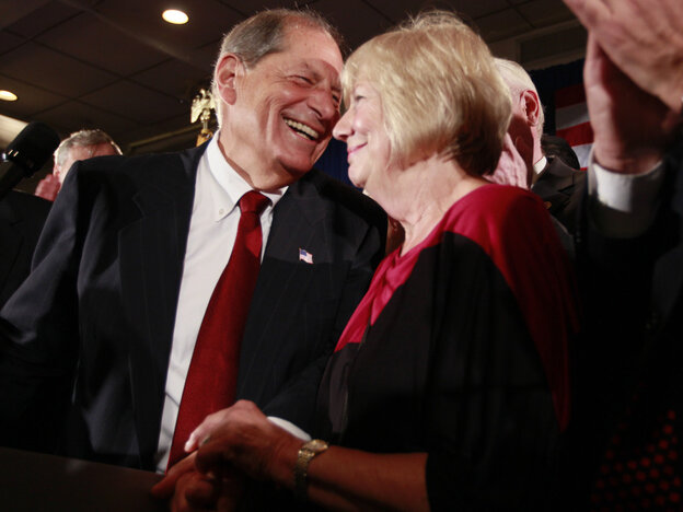 Republican Bob Turner, left, with wife Peggy enjoys his upset win, Sept. 13, 2011.