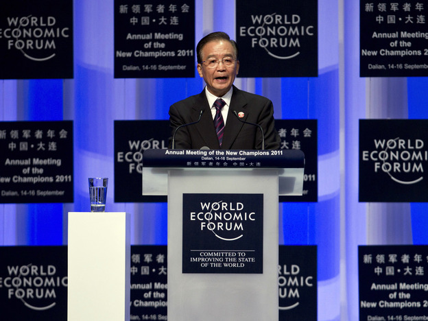 "Chinese Premier Wen Jiabao delivers an opening speech Wednesday at the World Economic Forum's Annual Meeting of the New Champions in Dalian, in northeast China. Wen said developed countries must ""first put their own house in order"" before they can expect China to help other struggling economies."