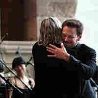 Wordless Music Orchestra conductor Ryan McAdams gives composer William Basinski a hug after the concert.