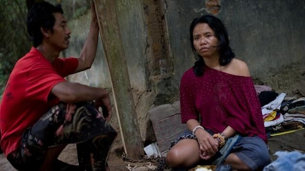 Nengah, 35, suffers from schizophrenia. Until recently, her family on Bali in Indonesia kept her chained to a concrete pit for nearly a decade.