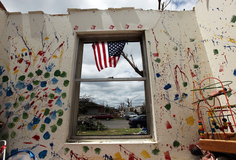 A child's room is seen in a destroyed home after the tornado passed through Joplin on May 26. The city's residents are still coping with losses from the storm, which damaged or destroyed an estimated 8,000 structures.