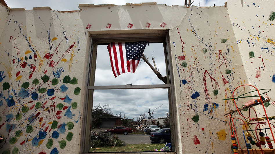 A child's room is seen in a destroyed home after the tornado passed through Joplin on May 26. The city's residents are still coping with losses from the storm, which damaged or destroyed an estimated 8,000 structures. (Getty Images)