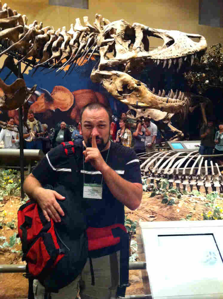 Carl Mehling, curator at the American Museum of Natural History in New York, just before exchanging the forgotten rib bone from the first T. rex. He's standing in front of the dinosaur's skeleton, which is now on display at the Carnegie Museum of Natural History in Pittsburgh.