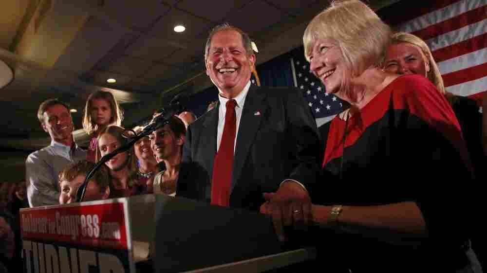 """Bob  Turner, center, joined by his wife Peggy,  right, and family smiles as he  delivers his victory speech during an  election night party in New York.  Turner says his shocking win in a heavily Democratic New York City district is a """"loud and clear"""" message to Washington."""