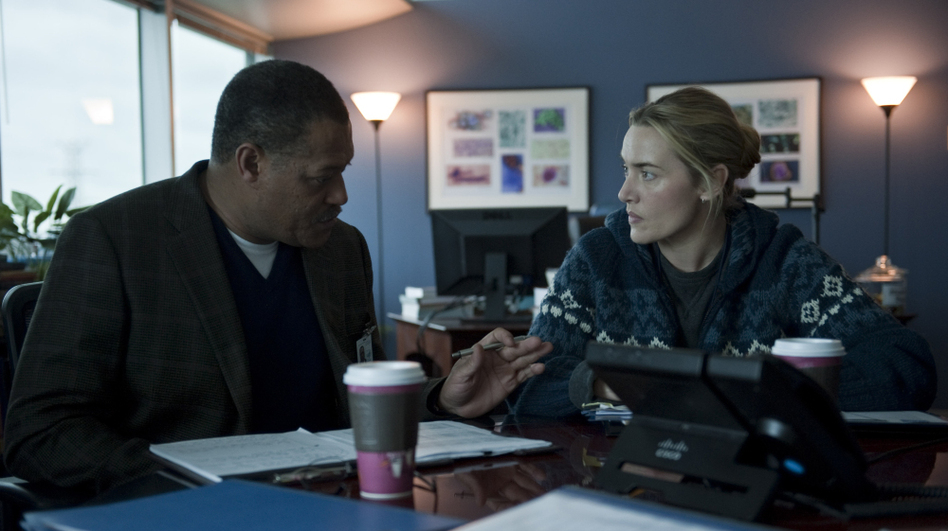 Laurence Fishburne as Dr. Ellis Cheever and Kate Winslet as Dr. Erin Mears in the thriller Contagion. Winslet's character was modeled on CDC epidemiologist Dr. Anne Schuchat. (Warner Bro. Pictures)