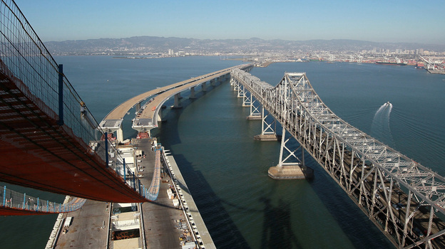 Catwalks hang over a section of the newly constructed eastern span of the San Francisco-Oakland Bay Bridge in Oakland, Calif.