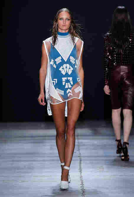 A sheer cover-up over a bright blue swim suit offers another take at layering, also courtesy Alexander Wang.