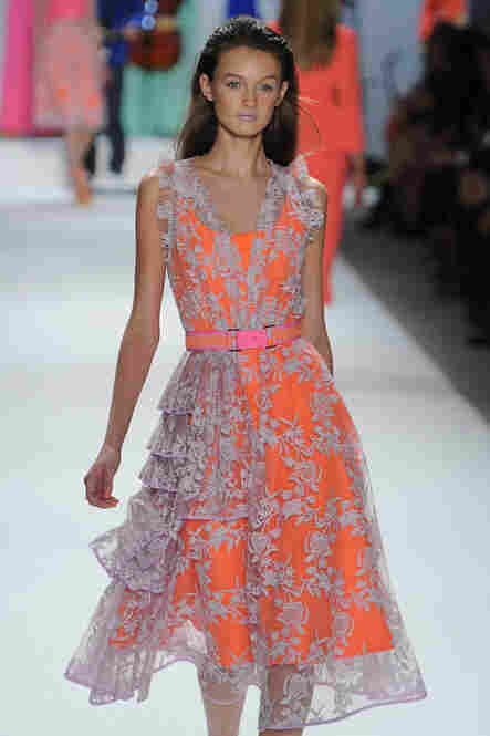 Nanette Lepore offered a feminine, layered look, with lace topping a strong tangerine day dress.