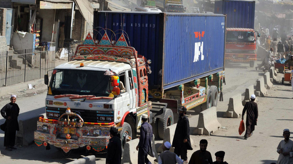 Trucks and tankers carrying supplies for NATO forces in Afghanistan arrive at the Pakistan's Torkham border crossing point before entering into Afghanistan in October 2010. The U.S. is increasingly relying on alternate routes that bypass Pakistan altogether.