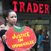 A protester outside a Trader Joe's in Washington, D.C. The Coalition of Immokalee Workers, which organized the protest, says Trader Joe's has refused to meet standards set by leaders of the  fast-food and foodservice industries for a more humane tomato  supply chain.