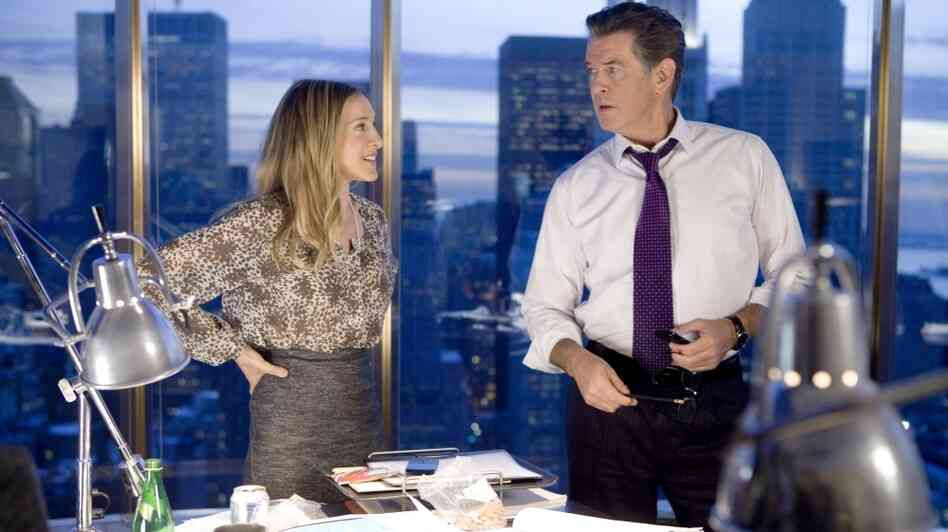 Hi, Finance! The perennial kittenish pertness of Sarah Jessica Parker (left, with Pierce Brosnan) makes her an unexpected choice for finance executive Kate Reddy, the too-much-isn't-enough heroine of I Don't Know How She Does It.