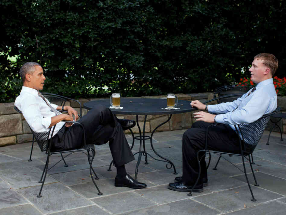 President Obama has a beer with Dakota Meyer on the patio outside of the Oval Office, Sept. 14, 2011.