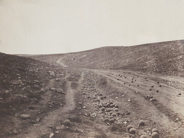 Some believe photographer Roger Fenton placed the cannonballs on the Ukrainian road during the Crimean War himself.