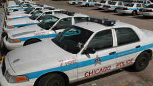 Ford Crown Victorias sit in a parking lot outside a police station in Chicago. Sales of the Crown Victoria climbed 140 percent in August as police departments stockpiled the popular fleet vehicle before Ford ended its production this week.
