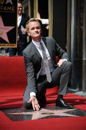 Actor Neil Patrick Harris shows off his star on the Hollywood Walk of Fame September 15, 2011.