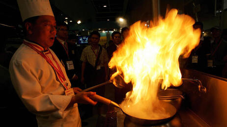 A Chinese chef demonstrates his cooking skills to visitors during the 12th Asian International Exhibition of Food and Drink, Hotel, Restaurant & Foodservice Equipment Supplies & Services (HOFEX) at the Hong Kong Exhibition Center in 2007.