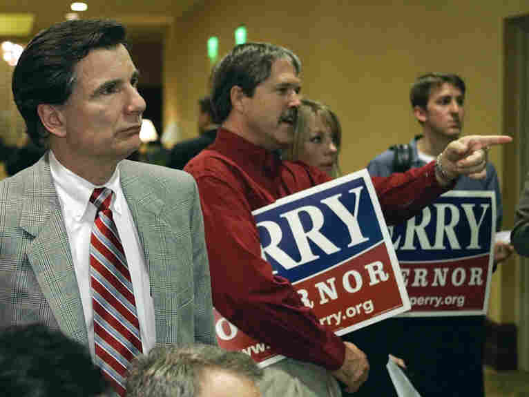 Mike Toomey (foreground), former chief of staff to Texas Gov. Rick Perry, watches primary election returns with other staffers in Austin in 2006.