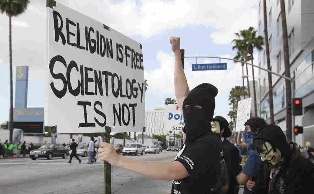 "Disguised members of the ""hacktivist"" group called Anonymous took to the streets of Los Angeles in March 2008 to protest near buildings associated with the Church of Scientology. Similar demonstrations were held in cities mainly in the U.S. and Europe."