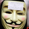 A demonstrator wears a Guy Fawkes mask typically worn by followers of the cyberguerrilla group Anonymous during an Aug. 15 protest inside a Bay Area Rapid Transit station in San Francisco.