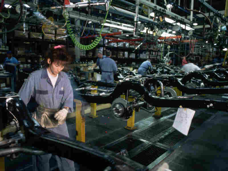 Christine Biekx works on car frames at the assembly line in Ford's St. Thomas, Ontario, plant in 1994. The plant closed this week. The Crown Victoria and the Lincoln Town Car are produced on the same frame, called the Ford Panther Platform, and fitted with separate bodies.