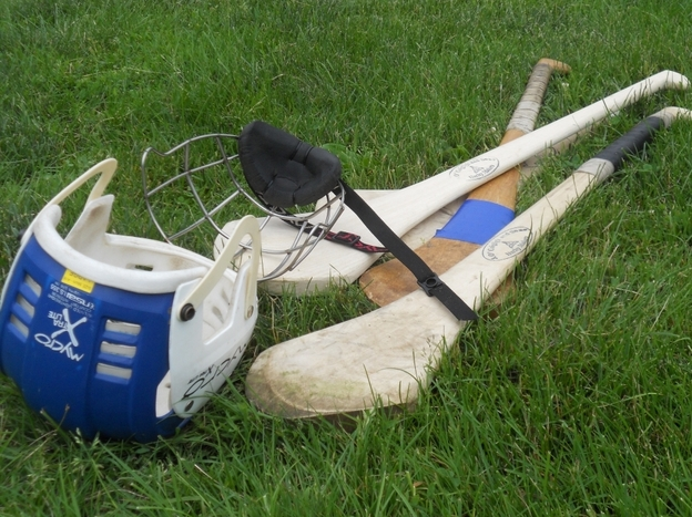 Hurling gear consists of a helmet, a wooden stick made of ash called a hurley,  and a ball called a sliotar.