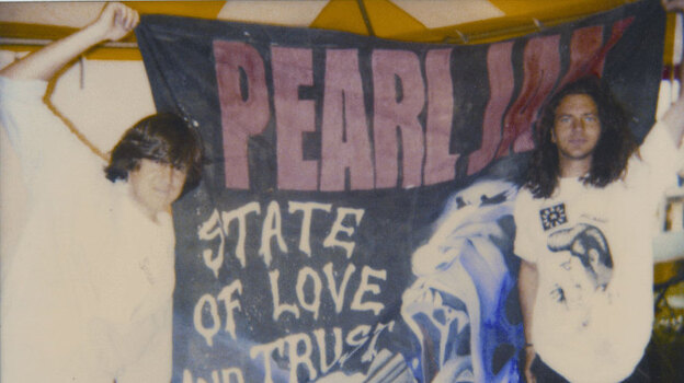 """Cameron Crowe (left) and Eddie Vedder in Italy in 1993. Vedder, Jeff Ament and Stone Gossard all appeared in Crowe's 1992 film Singles, set in Seattle's music scene. Pearl Jam contributed two songs, """"Breath"""" and """"State of Love and Trust,"""" to the film's soundtrack. (Courtesy of Vinyl Films)"""
