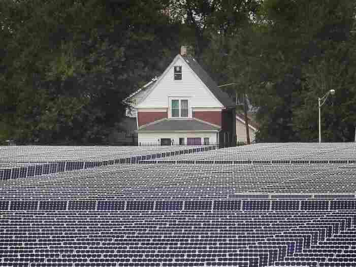 Solar photovoltaic panels generate electricity at an Exelon solar power  facility on Sept. 1, 2010 in Chicago, Illinois. The 10-megawatt  facility is the largest urban solar  installation in the United States.