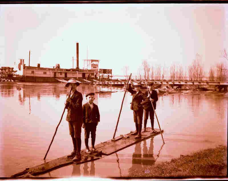 Boys on a raft near the batture.