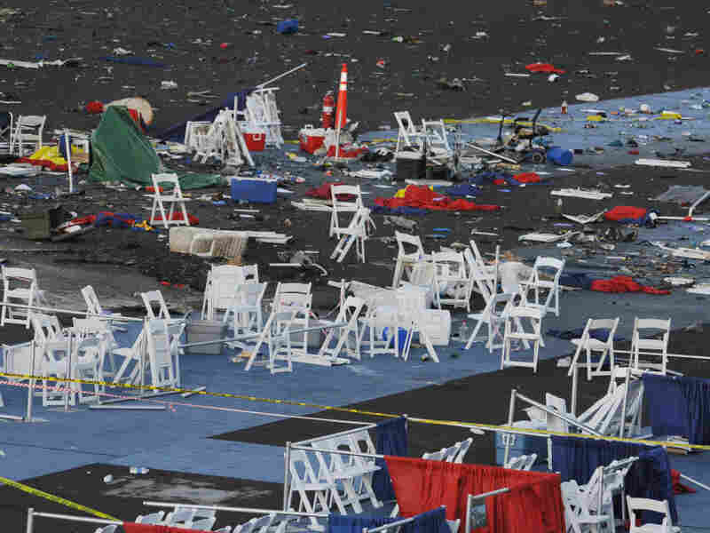Debris is shown at the Reno Air Races on Saturday, a day after the plane crash. At center left is a crater that authorities say is 6 feet six wide and 3 feet deep where the plane crashed.