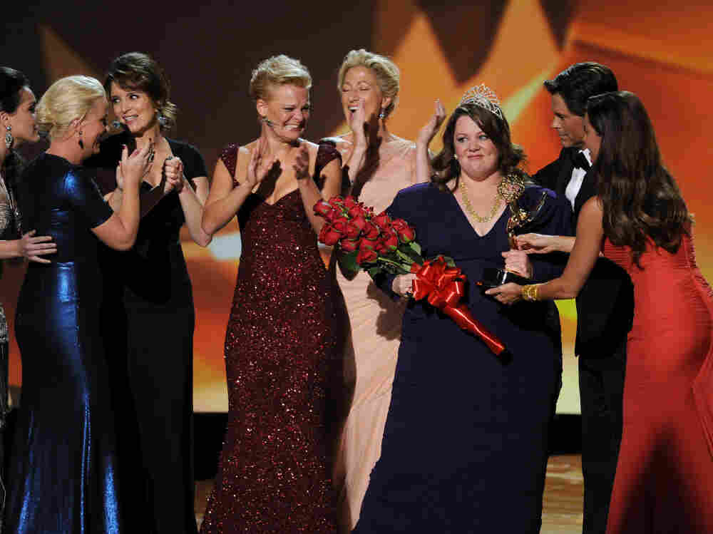 Melissa McCarthy accepts the Outstanding Lead Actress in a Comedy Series award onstage with Amy Poehler, Tina Fey, Martha Plimpton, Edie Falco, and presenters Rob Lowe and Sofia Vergara.
