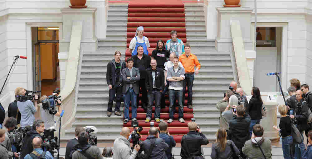 """Deputies of the Pirate Party pose in the House of Representatives in Berlin today. Free wireless Internet and public transport; voting rights for over-14s are just some of the policies of the """"Pirate Party."""""""