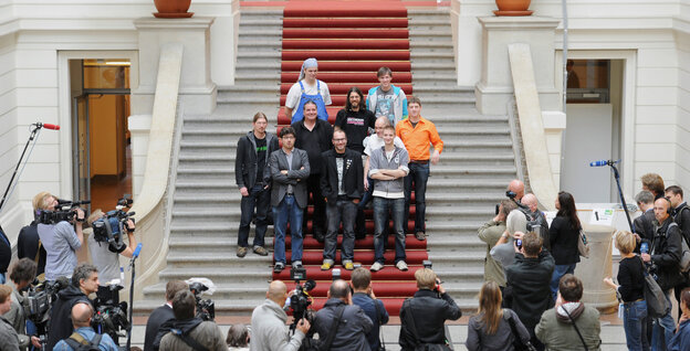 Deputies of the Pirate Party pose in the House of Representatives in Berlin today. Free wireless Internet and public transport; voting rights for over-14s are just some of the policies of the &qu