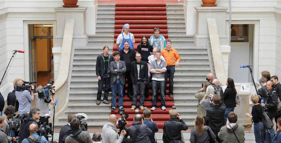 "Deputies of the Pirate Party pose in the House of Representatives in Berlin today. Free wireless Internet and public transport; voting rights for over-14s are just some of the policies of the ""Pirate Party."""
