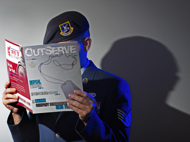 A gay member of the U.S. Air Force who wishes not to be identified reads a copy of the new magazine OutServe intended for actively serving lesbian, gay, bisexual and transgender U.S. military members earlier this month.