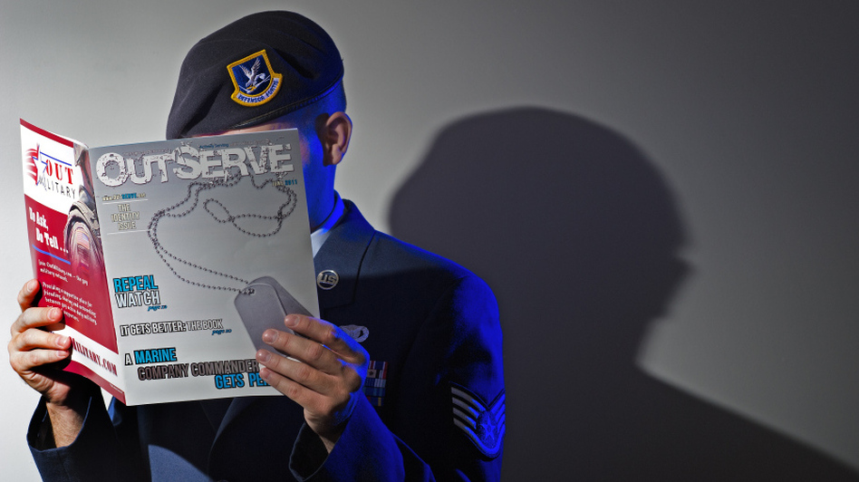 A gay member of the U.S. Air Force who wishes not to be identified reads a copy of the new magazine OutServe intended for actively serving lesbian, gay, bisexual and transgender U.S. military members earlier this month. (AFP/Getty Images)
