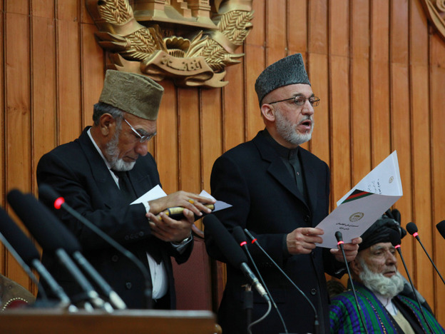 Afghan President Hamid Karzai (center) gives the oath to members of Afghanistan's new Parliament in Kabul on Jan. 26. His government  set up a special tribunal to re-examine the results of elections — marred by irregularities and charges of fraud — and Parliament bristled at what it saw as an overreach by the executive.