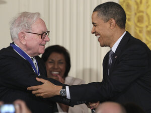 President Obama shakes hands with investor Warre