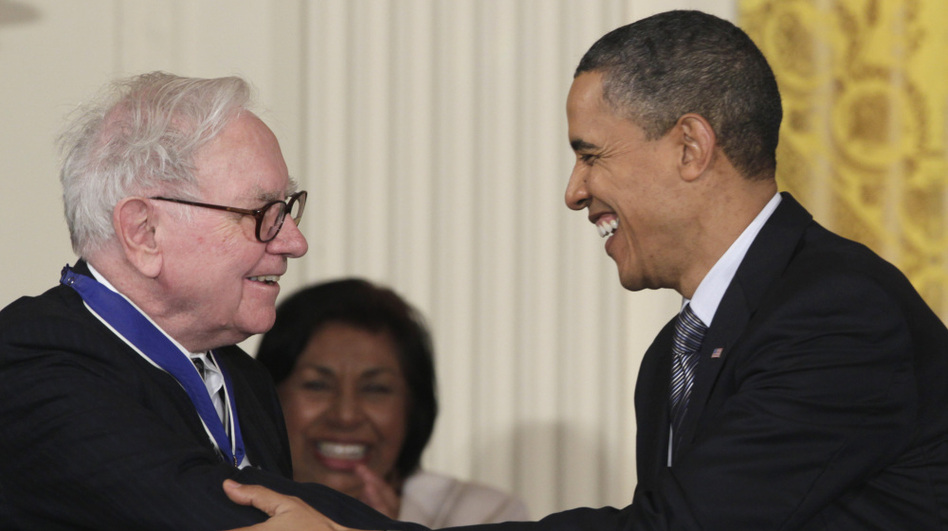 President Obama shakes hands with investor Warren Buffett after presenting him with a 2010 Presidential Medal of Freedom. One part of the president's deficit-reduction plan is named after Buffett, who suggested that high-income earners like him should pay more in taxes.