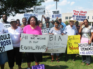 Black Freedmen, who are descended from the slaves of Cherokee Indians, protest  their expulsion on Sept.  2 outside a regional Bureau of Indian Affairs office in Muskogee, Okla. Marilyn Vann, in pink, is the president of the Desce