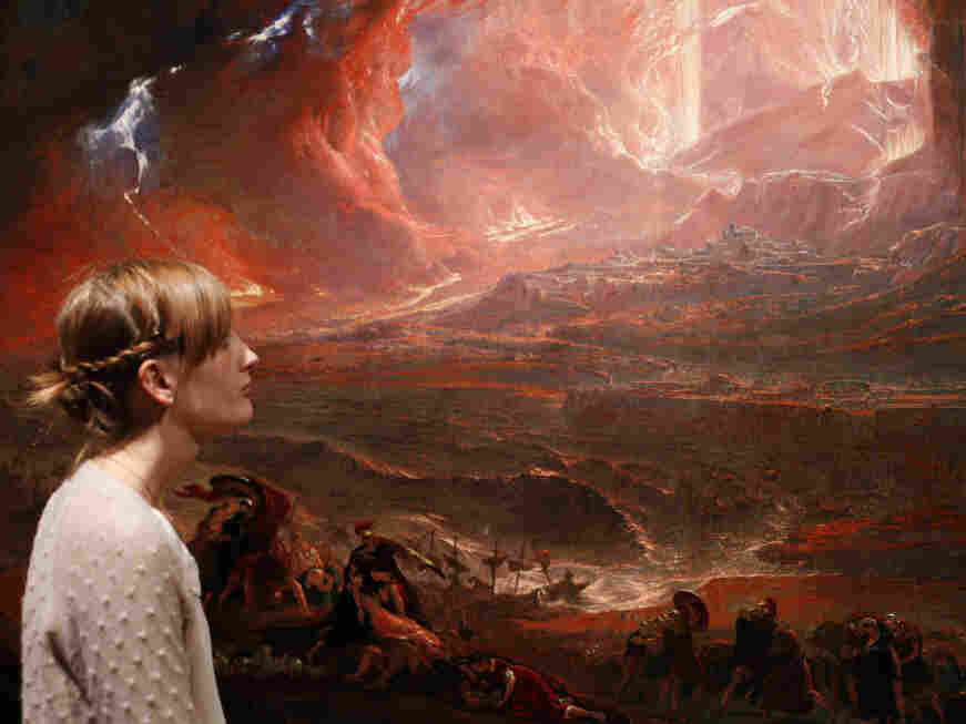 A museum employee looked at John Martin's recently restored The Destruction of Pompeii and Herculaneum, at the Tate Britain in central London on Monday (Sept. 19, 2011).