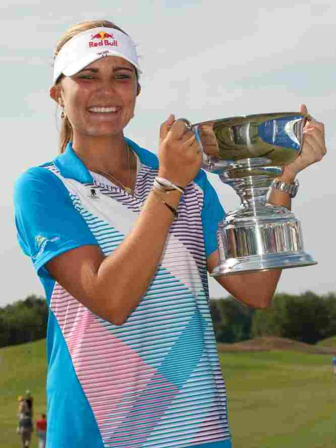 Lexi Thompson holds the champion's trophy after winning the  Navistar LPGA Classic on September 18, 2011 in Prattville, Alabama.