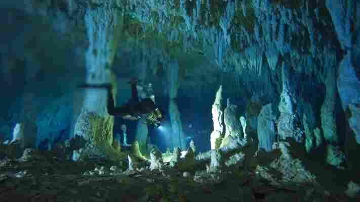 Kenny Broad negotiates the Cascade Room's stalagmites in Dan's Cave at Great Abaco Island, Bahama Islands.